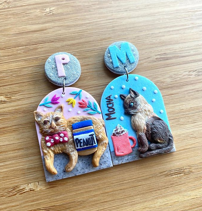 polymer clay earrings of two cats by klay and play